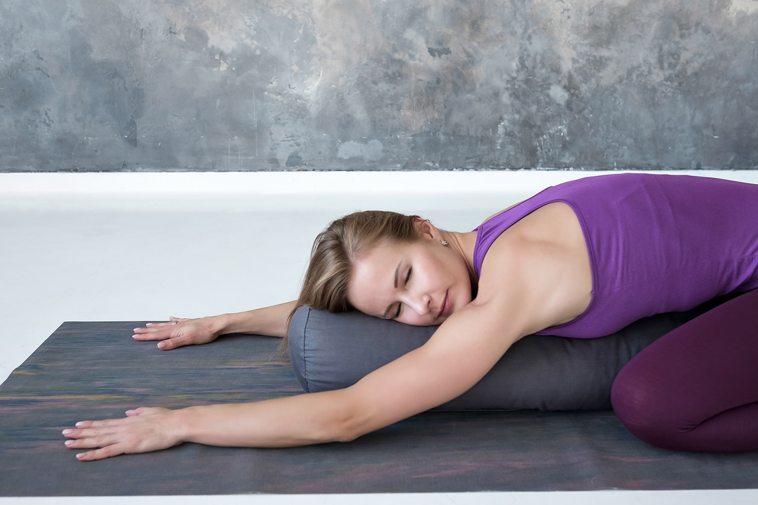 Slim woman doing yoga for spine and rest lying in Child Pose, Balasana Posture
